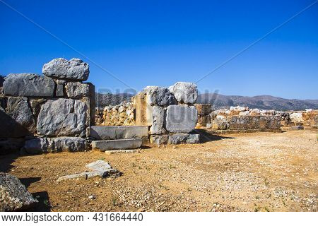 Ruins Of The Minoan Palace In Malia. Remains Of A Doorway. Malia Palace Archaeological Site, Greece,