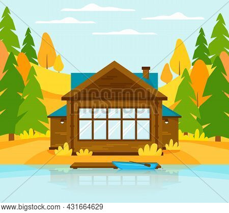 Wooden Cottage On Lake Or River With Pier. Holiday House In Autumn Landscape With Hills And Forest.