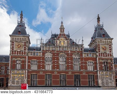 Amsterdam, Netherlands - August 14, 2021: Frontal Monumental Sculpted Red Stone Facade With Towers,