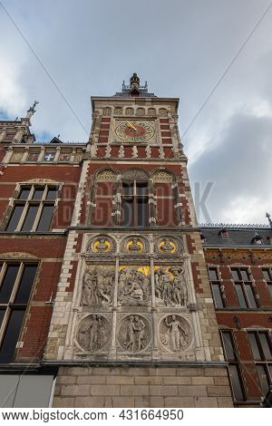 Amsterdam, Netherlands - August 14, 2021: Fresco Composition And Clock On Right Side Tower Of Centra