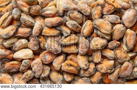 Frozen Peeled Mussel Meat As Background For Seafood Recipes. Iced Cooked Mussels Texture For Omega-3