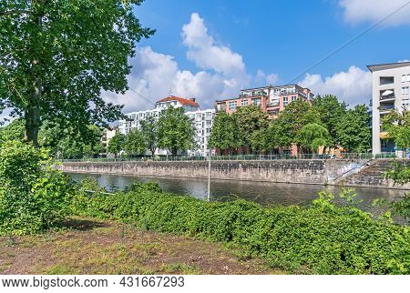 Berlin, Germany - July 3, 2021: Lined By Trees Bank Of The River Spree Hansa-ufer With River Walk An