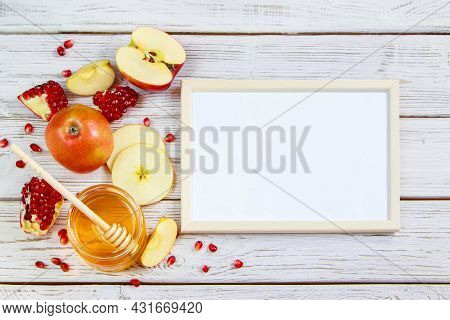 Apples, Pomegranates And Honey On A White Wooden Background. Happy Rosh Hashanah. Traditional Symbol