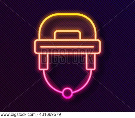 Glowing Neon Line Hockey Helmet Icon Isolated On Black Background. Vector