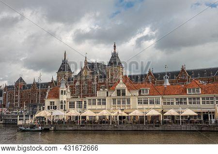 Amsterdam, Netherlands - August 14, 2021: Beige With Red Roof Restaurant Tearoom Loetje On Ponton In