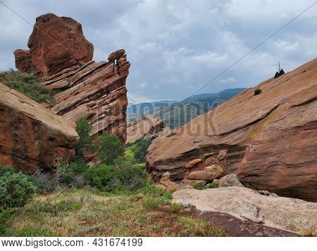 View Of Rock Formations From Red Rocks Trading Post Trail Near Morrison, Colorado Under Dramatic Sum
