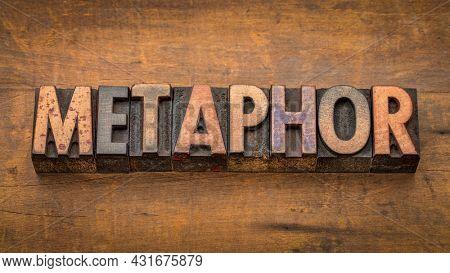 metaphor, a figure of speech - word abstract in vintage letterpress wood type against rustic wood