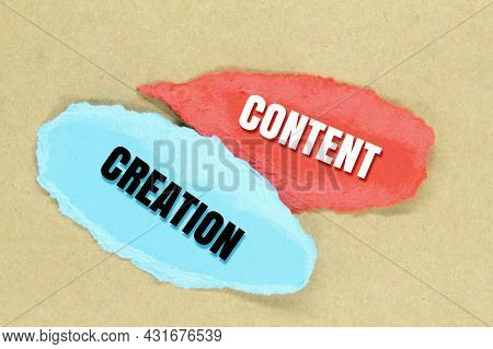 Colored Paper Torn With The Words Content Creation