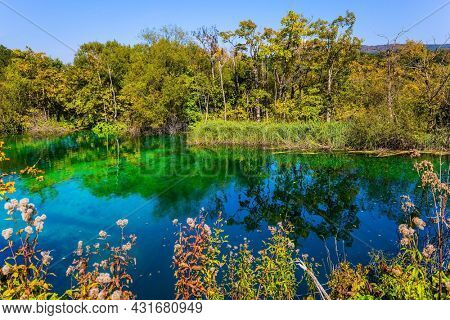Plitvice Lakes Park in Croatia. Plitvice Lakes are beautiful karst lakes of all shades of turquoise and aquamarine, located in a cascade. Travel to Central Europe
