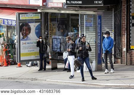 Bronx, New York/usa - May 18, 2020: People Waiting For Local Bus While Wearing Protective Masks.
