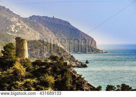 Coastal Landscape With Watchtower. Torre Del Pino, Pine Tower On Cliffs Of Maro Cerro Gordo Natural