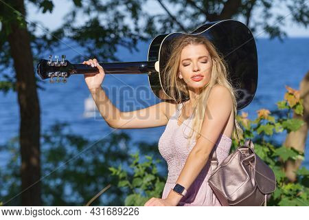 Hippie Looking Young Adult Woman Wearing Gypsy Outfit Having Acoustic Guitar. Female Playing Music I