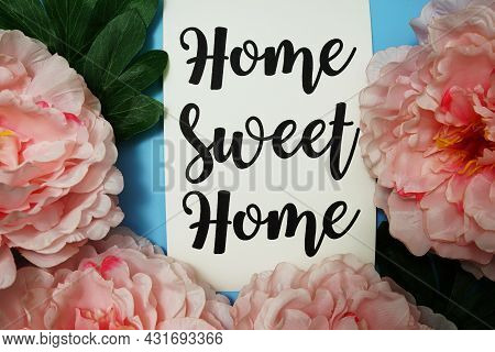 Home Sweet Home Typography Text With Peony Flowers On Blue Background