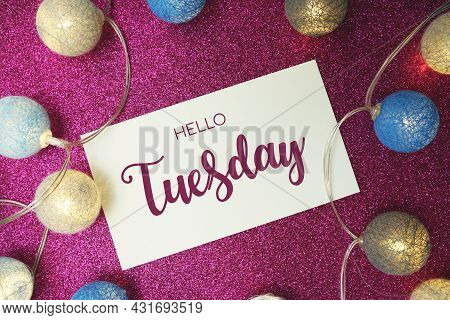 Hello Tuesday Typography Text With Led Cotton Ball On Pink Glitter Background
