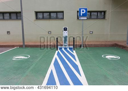 Place Marked With Machine For Charging Public Electric Cars, Two Places.