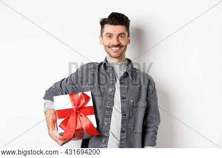 Happy Valentines Day. Smiling Handsome Man Bring Gift On Romantic Date, Holding Box With Present And