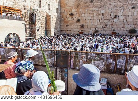 JERUSALEM, ISRAEL - NOVEMBER 16, 2011: The Western Wall - place of faith and pilgrimage for Jews around the world. Great religious Jewish holiday.