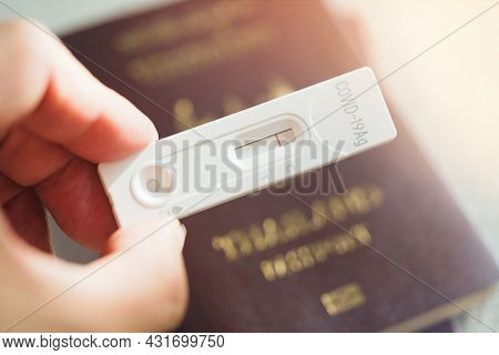 Rapid Serology Antigen Covid-19 Test On Passport And Surgical Mask, Travel During The Pandemic Of Co