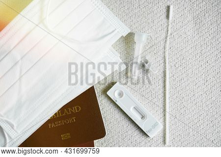 Rapid Serology Antigen Covid-19 Test Kit Put On Fabric With Passport And Surgical Mask, Travel Durin