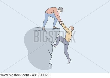 Helping Hand And Assistance Concept. Young Man Standing On Peak Of Rock Giving Hand To Help His Frie