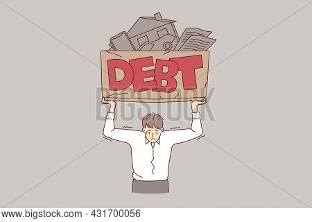 Financial Crisis And Debt Concept. Young Frustrated Stressed Businessman Standing Holding Box With D