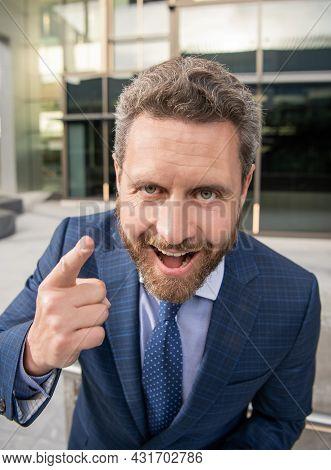 Happy Handsome Entrepreneur In Businesslike Suit Outside The Office Point Finger, Emotions