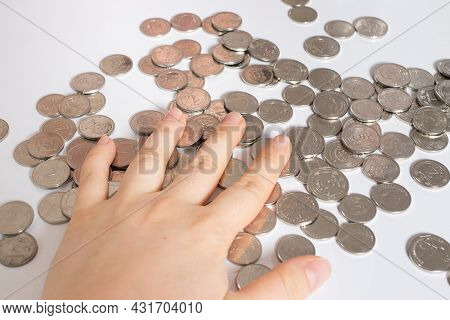 Ukrainian Hryvnia, The Currency Of Ukraine. Man And Coins Hand Close-up. Finance, Rising Tariffs And