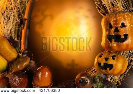 Halloween Pumpkin And Graveyard Blurred Background In The Full Moon Night With Copy Space,halloween