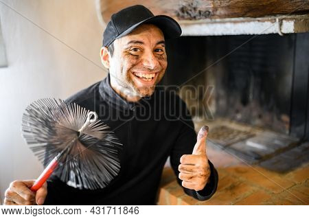 Young chimney sweep portrait in a house giving thumbs up