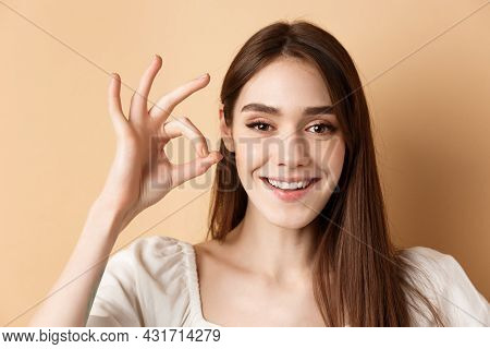 Cheerful Pretty Girl Show Okay Sign And Smile At Camera, Praise Good Product, Nice Job Gesture, Stan