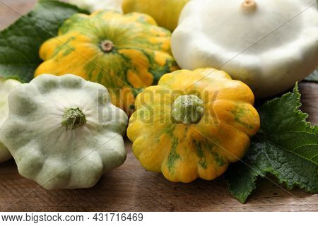 Fresh Ripe Pattypan Squashes With Leaves On Wooden Table, Closeup
