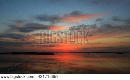Nice sunset sky over lake water surface
