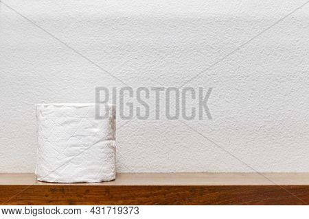 New Rolls Of Tissue Paper On A Wooden Shelf In The Bathroom