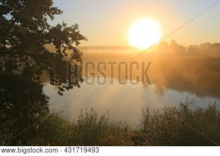 Morning landscape with sunrise over small lake in steppe