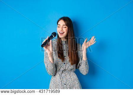 Beautiful Candid Girl Singing In Microphone, Close Eyes And Smile Carefree, Sing At Karaoke. Leisure