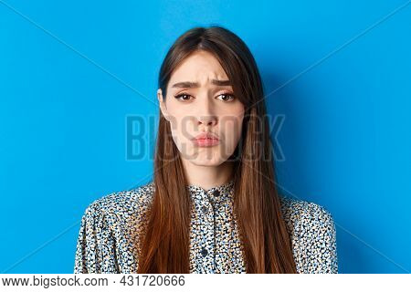 People Emotions Concept. Sad Cute Girl Begging For Something, Pucker Lips And Frowning, Whining Aski