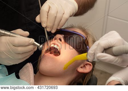 A Girl With Teeth Palatal Expander In Her Mouth. Orthodontic Treatment. Orthodontist With Patient. G
