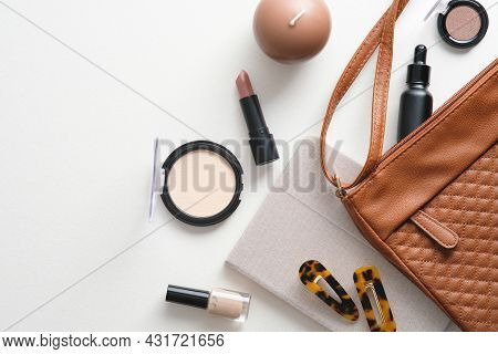 Make-up Cosmetic Bag On White Background. Glamour Makeup Artist Pouch With Beauty Products. Flat Lay