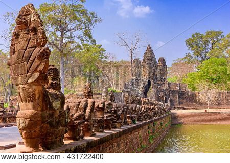 Guardians Statues On The Bridge At South Gate Of Angkor Thom In Siem Reap, Cambodia.