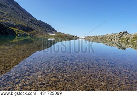 Lake Le Lac Blanc, Alpes Dhuez. French Alps. Reflection And Blue Sky.