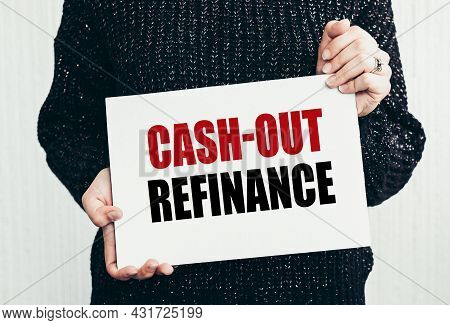 Girl Holding A Card With Text Cash-out Refinance.