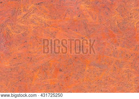 Red Chipboard Brown Particleboard Pattern Pressed Wood Material Surface Texture Background.