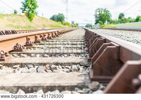 Railway Track Details Closeup Photo With Selective Focus.close-up View Of Railway Bolts.summer Day D
