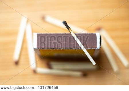 Selective Focus Of Wooden Matches,cardboard,burnt Match.matchsticks On Yellow Wooden Blurred Backgro