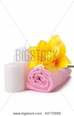 Two Candles, Pink Towel And Yellow Flower. Spa Composition