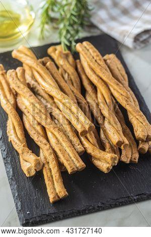 Grissini sticks. Traditional italian bread sticks on cutting board.
