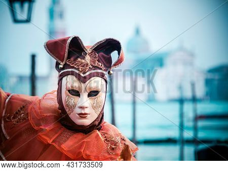 Venice, Italy - 02 14 2012: A Traditional Joker Mask At The Famous Venetian Carnival Where People Sh