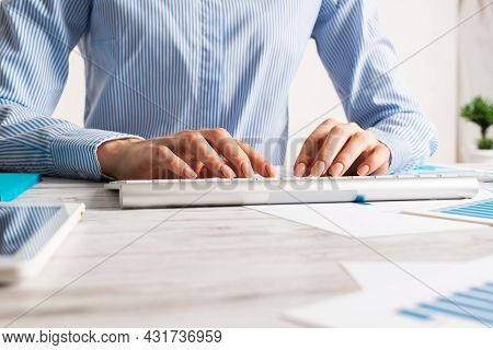 Manager Typing On Computer Keyboard At Wooden Desk. Strategy Planning And Banking. Financial Analyst