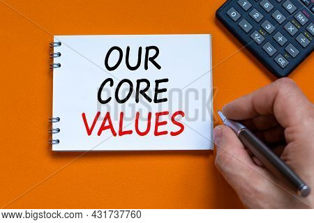 Our Core Values Symbol. Businessman Writing Words 'our Core Values' On White Note. Black Calculator.