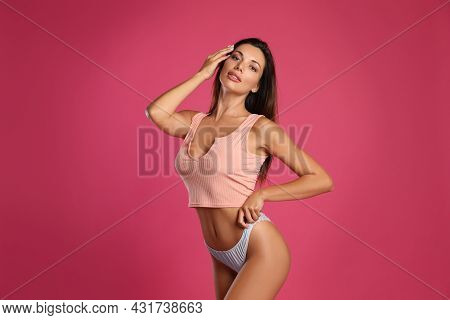 Beautiful Woman In White Sexy Panties And Top On Pink Background